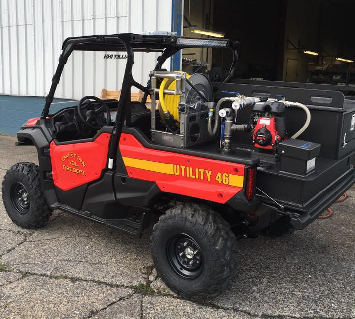 utility 4x4 with custom skid on back for hard to reach areas